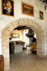 Collazzone farmhouse photo - Brick archways between rooms