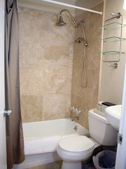 Mission Beach condo photo - The travertine bathroom