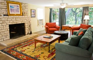 Wimberley property rental photo - Large master suite with sitting area and a wood burning fireplace.