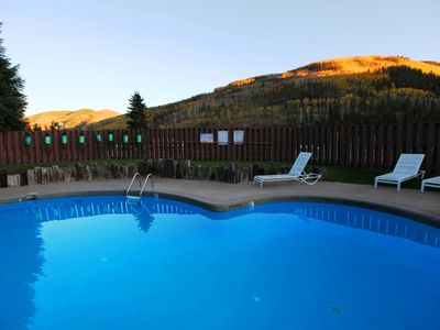 Heated outdoor pool with view towards Vail mountain.