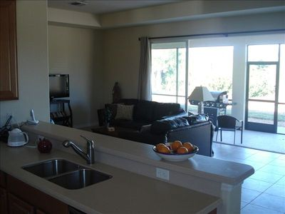 Plantation house rental - Kitchen, living room & lanai (screened in sun room)