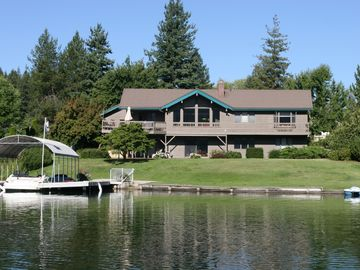 Sandpoint house rental - View of the house and private dock from the water