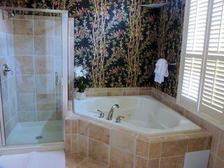 Master Bath with Private Jacuzzi Tub and Shower.