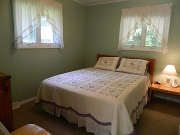 Bedroom with queen bed on main level