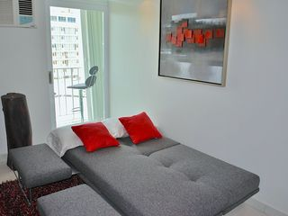 Isla Verde apartment photo - Sofa converts into a full size bed. Also has a foot rest area