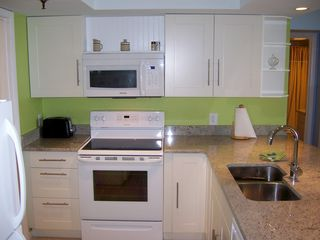 Redington Shores condo photo - The kitchen is brand new right down to the silverware and includes ample storage