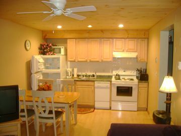 Clean updated full kitchen with hardwood floors and new pine ceiling.
