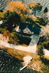 Muskegon house photo - Arial view of property showing lake front and back.