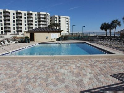 Islander Destin condo rental - Just steps from your door to the pools and to the beach shown above!
