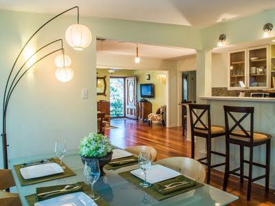 From dining area w/ contemporary lighting open to front living area of home