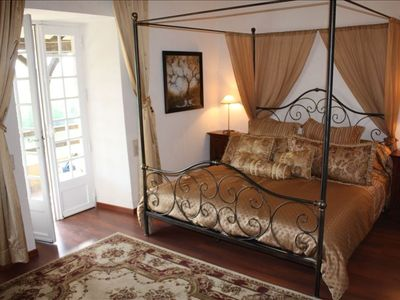 Romantic master bedroom with King size four poster bed and private bath