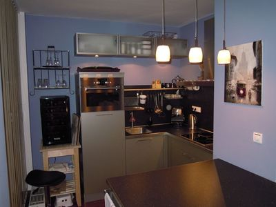 Closer view of kitchen.