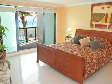 Master bedroom overlooking beach and pool