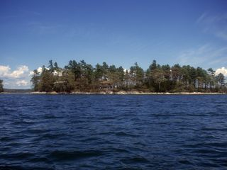 Freeport house photo - A view from the west to our little island home which can be seen.
