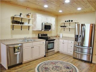 Burt Lake cabin photo - Brand new, high end, wide open kitchen with ... A Dish Washer...Yea!