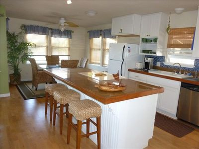 Fully equipped gourmet kitchen with ocean view dining table