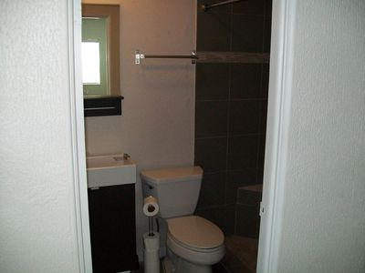 Full bath with walkin shower and builtin seat.