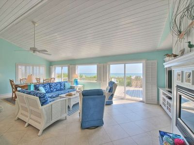 Walls of windows and doors bring the ocean views right into the living area!