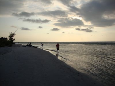 Enjoy a tranquil evening of fishing on the white sandy shores of Gasparilla Pass