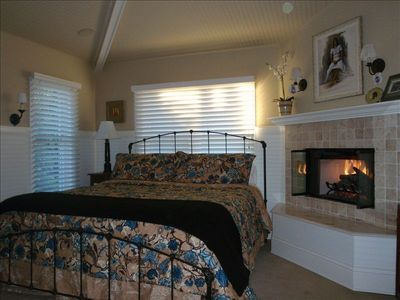 Upper floor, Master Suite with Cal King iron bed, Fireplace and tree top views.