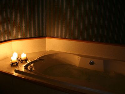 Relaxing bliss in oversized whirlpool tub.