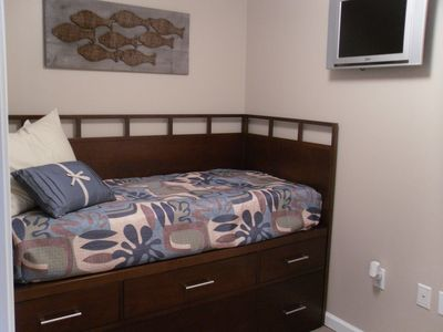 Second bedroom with twin trundle bed and flat screen TV