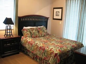 Queen bed in 1 of 3 bedrooms. Also has own private full bathroom with tub.