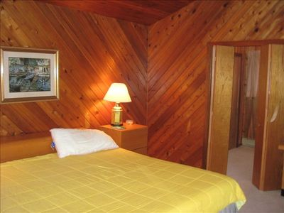 Port Carling cottage rental - Master Bedroom (King Sized bed) with walk-in closet to the side.