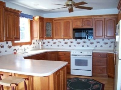 Very modern kitchen with cherry cabinets & all amenities.