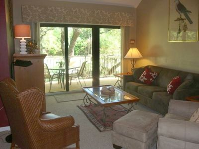 Relax in the living room  with TV, DVD & large deck overlooking golf course