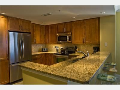 Gourmet Kitchen, featuring granite countertops & long Breakfast Bar