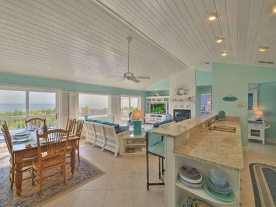 The living-dining-kitchen area is spacious and open to the deck and ocean views!