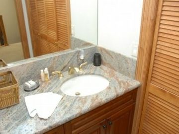 There is a full bathroom on the second floor complete with granite counter tops, a single sink, shower/tub, and a toilet. Also, behind the wood doors seen in the picture are the washer/dryer. That way, you can pack light or dry wet winter clothing.