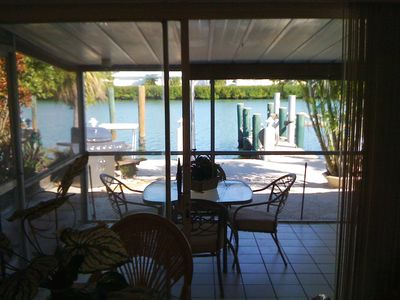Screend in Patio with great views of the waterway and dock