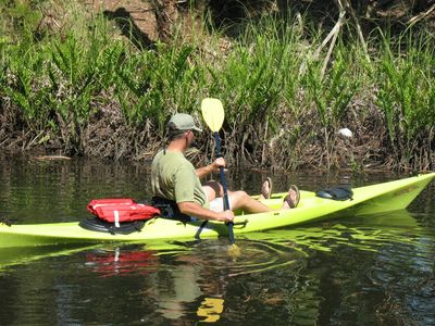 A guest using one of the two kayaks