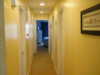 Hallway from Living Room and Dining Area to Bedrooms - Wildwood condo vacation rental photo