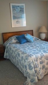 Bedroom with Queen Bed, Full Bath and windows with beach view!