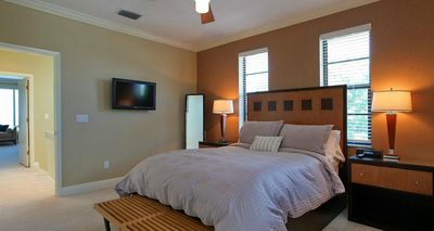 Bedroom With Queen Sized Bed And Flat Screen TV