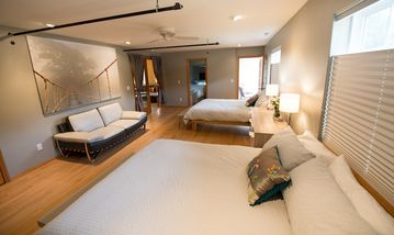 Master Bedroom suite with two queens and private bath, balcony and leather couch