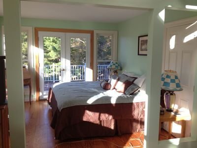 master bedroom with porch overlooking rear yard  deck and tennis court