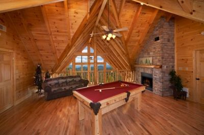 The woodwork and hand hewn logs in the loft are phenomenal !!