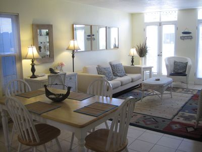 Beautifully furnished living room. French doors open to private patio.