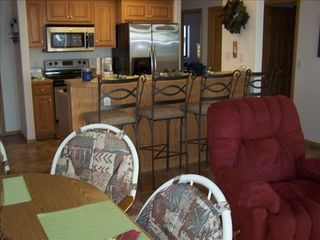 Lake Ozark condo photo - Full kitchen-all stainless steel/bar & dining area