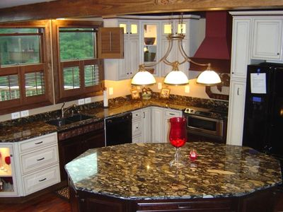 Gourmet Kitchen with upgraded appliances and stunning granite counter tops
