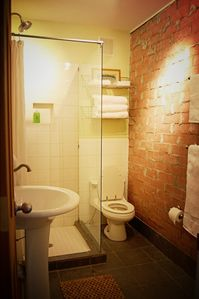 Nice-sized bathroom with rain shower head.