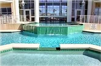 A Two Tiered pool with Water fall, Pools are heated for Spring and Fall