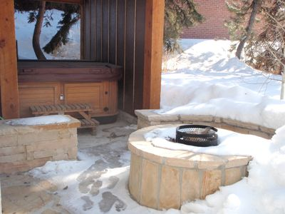 Hot tub and fire pit on back patio