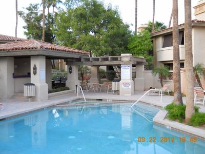 Phoenix townhome rental - One of 3 pool, hot tub and BBQ areas at the condo. Electric BBQ on condo Patio.