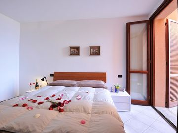 Spacious bedrooms with access to the terrace
