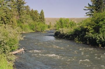 The Wind River runs within a few hundred feet of the ranch property boundary